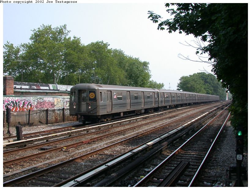 (156k, 820x620)<br><b>Country:</b> United States<br><b>City:</b> New York<br><b>System:</b> New York City Transit<br><b>Line:</b> BMT Brighton Line<br><b>Location:</b> Avenue J <br><b>Route:</b> Q<br><b>Car:</b> R-68 (Westinghouse-Amrail, 1986-1988)  2854 <br><b>Photo by:</b> Joe Testagrose<br><b>Date:</b> 6/11/2002<br><b>Viewed (this week/total):</b> 1 / 3181
