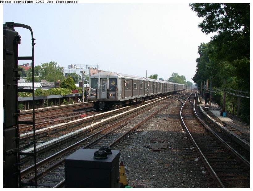 (133k, 820x620)<br><b>Country:</b> United States<br><b>City:</b> New York<br><b>System:</b> New York City Transit<br><b>Line:</b> BMT Brighton Line<br><b>Location:</b> Kings Highway <br><b>Route:</b> Q<br><b>Car:</b> R-40 (St. Louis, 1968)  4164 <br><b>Photo by:</b> Joe Testagrose<br><b>Date:</b> 6/11/2002<br><b>Viewed (this week/total):</b> 1 / 2674