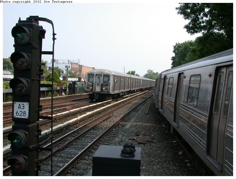 (128k, 820x620)<br><b>Country:</b> United States<br><b>City:</b> New York<br><b>System:</b> New York City Transit<br><b>Line:</b> BMT Brighton Line<br><b>Location:</b> Kings Highway <br><b>Route:</b> Q<br><b>Car:</b> R-40 (St. Louis, 1968)  4168 <br><b>Photo by:</b> Joe Testagrose<br><b>Date:</b> 6/11/2002<br><b>Viewed (this week/total):</b> 0 / 3146