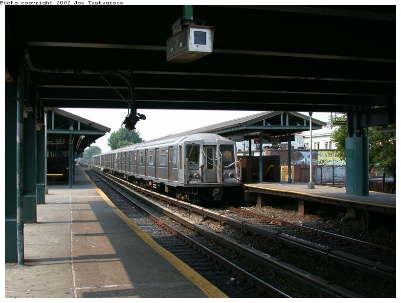 (115k, 820x620)<br><b>Country:</b> United States<br><b>City:</b> New York<br><b>System:</b> New York City Transit<br><b>Line:</b> BMT Brighton Line<br><b>Location:</b> Kings Highway <br><b>Route:</b> Q<br><b>Car:</b> R-40 (St. Louis, 1968)  4173 <br><b>Photo by:</b> Joe Testagrose<br><b>Date:</b> 6/11/2002<br><b>Viewed (this week/total):</b> 3 / 3465