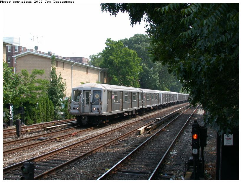 (152k, 820x620)<br><b>Country:</b> United States<br><b>City:</b> New York<br><b>System:</b> New York City Transit<br><b>Line:</b> BMT Brighton Line<br><b>Location:</b> Avenue H <br><b>Route:</b> Q<br><b>Car:</b> R-40 (St. Louis, 1968)  4214 <br><b>Photo by:</b> Joe Testagrose<br><b>Date:</b> 6/11/2002<br><b>Viewed (this week/total):</b> 1 / 3990