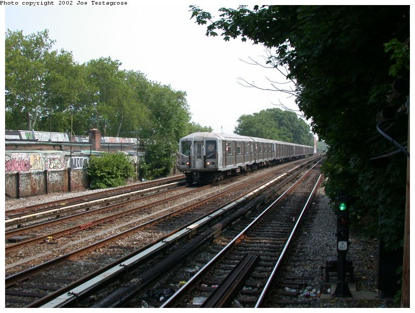 (151k, 820x620)<br><b>Country:</b> United States<br><b>City:</b> New York<br><b>System:</b> New York City Transit<br><b>Line:</b> BMT Brighton Line<br><b>Location:</b> Avenue J <br><b>Route:</b> Q<br><b>Car:</b> R-40 (St. Louis, 1968)  4241 <br><b>Photo by:</b> Joe Testagrose<br><b>Date:</b> 6/11/2002<br><b>Viewed (this week/total):</b> 0 / 3240