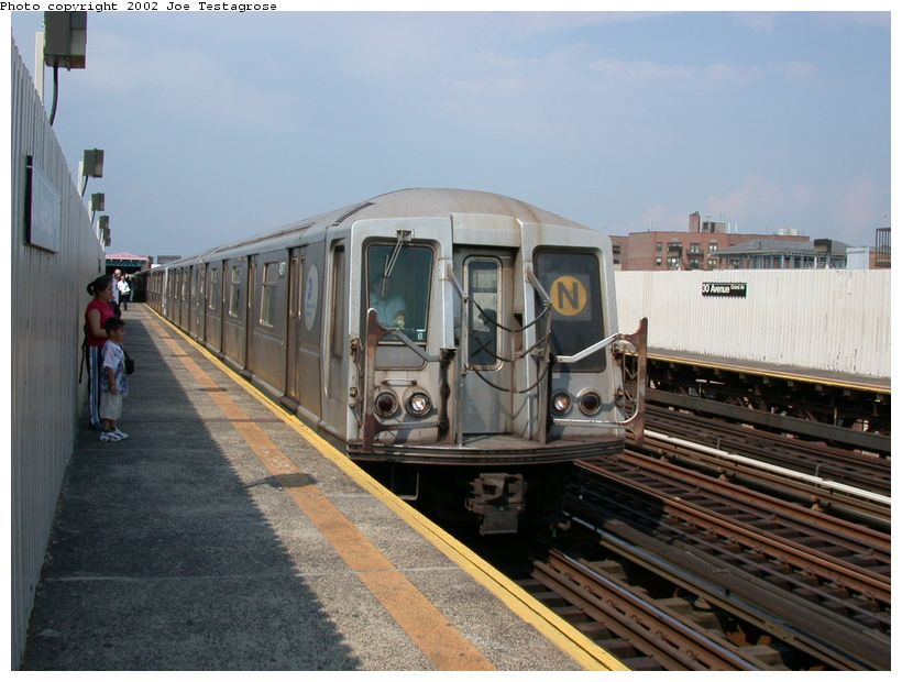 (117k, 820x620)<br><b>Country:</b> United States<br><b>City:</b> New York<br><b>System:</b> New York City Transit<br><b>Line:</b> BMT Astoria Line<br><b>Location:</b> 30th/Grand Aves. <br><b>Route:</b> N<br><b>Car:</b> R-40 (St. Louis, 1968)  4277 <br><b>Photo by:</b> Joe Testagrose<br><b>Date:</b> 6/19/2002<br><b>Viewed (this week/total):</b> 1 / 3743