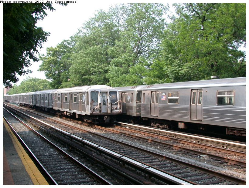 (180k, 820x620)<br><b>Country:</b> United States<br><b>City:</b> New York<br><b>System:</b> New York City Transit<br><b>Line:</b> BMT Brighton Line<br><b>Location:</b> Avenue M <br><b>Route:</b> Q<br><b>Car:</b> R-40 (St. Louis, 1968)  4311 <br><b>Photo by:</b> Joe Testagrose<br><b>Date:</b> 6/11/2002<br><b>Viewed (this week/total):</b> 0 / 3486