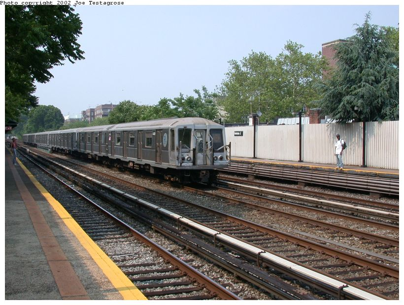 (154k, 820x620)<br><b>Country:</b> United States<br><b>City:</b> New York<br><b>System:</b> New York City Transit<br><b>Line:</b> BMT Brighton Line<br><b>Location:</b> Avenue J <br><b>Route:</b> Q<br><b>Car:</b> R-40 (St. Louis, 1968)  4328 <br><b>Photo by:</b> Joe Testagrose<br><b>Date:</b> 6/11/2002<br><b>Viewed (this week/total):</b> 4 / 2588
