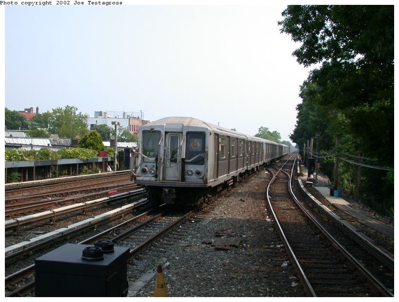 (129k, 820x620)<br><b>Country:</b> United States<br><b>City:</b> New York<br><b>System:</b> New York City Transit<br><b>Line:</b> BMT Brighton Line<br><b>Location:</b> Kings Highway <br><b>Route:</b> Q<br><b>Car:</b> R-40 (St. Louis, 1968)  4376 <br><b>Photo by:</b> Joe Testagrose<br><b>Date:</b> 6/11/2002<br><b>Viewed (this week/total):</b> 0 / 3050