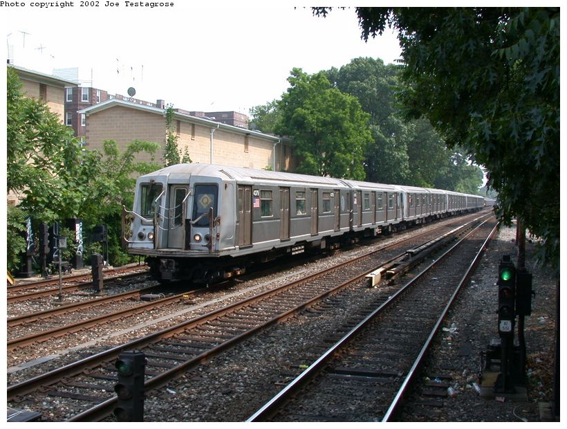 (158k, 820x620)<br><b>Country:</b> United States<br><b>City:</b> New York<br><b>System:</b> New York City Transit<br><b>Line:</b> BMT Brighton Line<br><b>Location:</b> Avenue H <br><b>Route:</b> Q<br><b>Car:</b> R-40 (St. Louis, 1968)  4379 <br><b>Photo by:</b> Joe Testagrose<br><b>Date:</b> 6/11/2002<br><b>Viewed (this week/total):</b> 2 / 2674