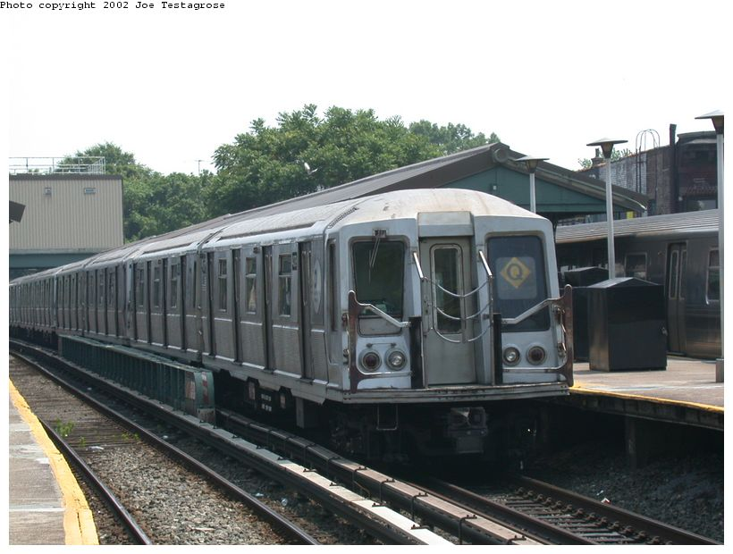 (116k, 820x620)<br><b>Country:</b> United States<br><b>City:</b> New York<br><b>System:</b> New York City Transit<br><b>Line:</b> BMT Brighton Line<br><b>Location:</b> Kings Highway <br><b>Route:</b> Q<br><b>Car:</b> R-40 (St. Louis, 1968)  4379 <br><b>Photo by:</b> Joe Testagrose<br><b>Date:</b> 6/11/2002<br><b>Viewed (this week/total):</b> 1 / 2894