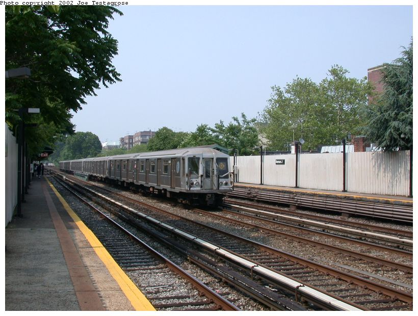 (143k, 820x620)<br><b>Country:</b> United States<br><b>City:</b> New York<br><b>System:</b> New York City Transit<br><b>Line:</b> BMT Brighton Line<br><b>Location:</b> Avenue J <br><b>Route:</b> Q<br><b>Car:</b> R-40 (St. Louis, 1968)  4385 <br><b>Photo by:</b> Joe Testagrose<br><b>Date:</b> 6/11/2002<br><b>Viewed (this week/total):</b> 0 / 2898