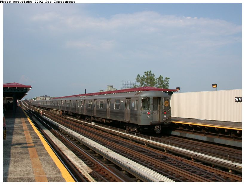 (110k, 820x620)<br><b>Country:</b> United States<br><b>City:</b> New York<br><b>System:</b> New York City Transit<br><b>Line:</b> BMT Astoria Line<br><b>Location:</b> 39th/Beebe Aves. <br><b>Route:</b> W<br><b>Car:</b> R-68A (Kawasaki, 1988-1989)  5088 <br><b>Photo by:</b> Joe Testagrose<br><b>Date:</b> 6/19/2002<br><b>Viewed (this week/total):</b> 2 / 2555