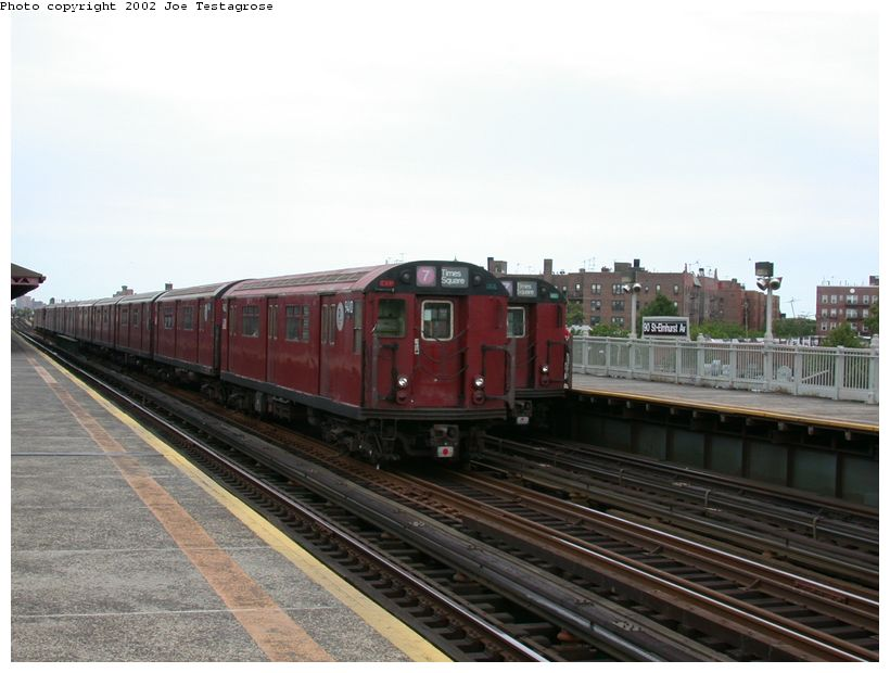 (106k, 820x620)<br><b>Country:</b> United States<br><b>City:</b> New York<br><b>System:</b> New York City Transit<br><b>Line:</b> IRT Flushing Line<br><b>Location:</b> 90th Street/Elmhurst Avenue <br><b>Route:</b> 7<br><b>Car:</b> R-36 World's Fair (St. Louis, 1963-64) 9410 <br><b>Photo by:</b> Joe Testagrose<br><b>Date:</b> 6/4/2002<br><b>Viewed (this week/total):</b> 3 / 2690