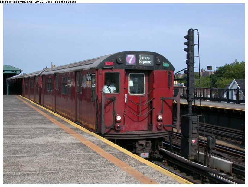 (121k, 820x620)<br><b>Country:</b> United States<br><b>City:</b> New York<br><b>System:</b> New York City Transit<br><b>Line:</b> IRT Flushing Line<br><b>Location:</b> 69th Street/Fisk Avenue <br><b>Route:</b> 7<br><b>Car:</b> R-36 World's Fair (St. Louis, 1963-64) 9696 <br><b>Photo by:</b> Joe Testagrose<br><b>Date:</b> 6/4/2002<br><b>Viewed (this week/total):</b> 0 / 3029
