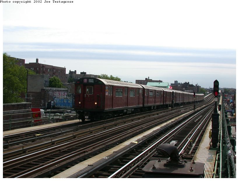 (119k, 820x620)<br><b>Country:</b> United States<br><b>City:</b> New York<br><b>System:</b> New York City Transit<br><b>Line:</b> IRT Flushing Line<br><b>Location:</b> 82nd Street/Jackson Heights <br><b>Route:</b> 7<br><b>Car:</b> R-36 World's Fair (St. Louis, 1963-64) 9727 <br><b>Photo by:</b> Joe Testagrose<br><b>Date:</b> 6/4/2002<br><b>Viewed (this week/total):</b> 0 / 1850