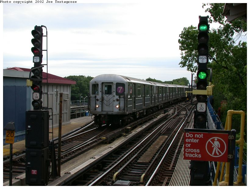 (128k, 820x620)<br><b>Country:</b> United States<br><b>City:</b> New York<br><b>System:</b> New York City Transit<br><b>Line:</b> IRT Flushing Line<br><b>Location:</b> Willets Point/Mets (fmr. Shea Stadium) <br><b>Route:</b> 7<br><b>Car:</b> R-62A (Bombardier, 1984-1987)  1715 <br><b>Photo by:</b> Joe Testagrose<br><b>Date:</b> 6/4/2002<br><b>Viewed (this week/total):</b> 2 / 2746