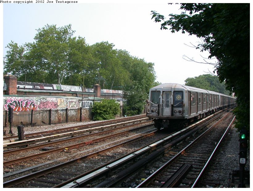 (159k, 820x620)<br><b>Country:</b> United States<br><b>City:</b> New York<br><b>System:</b> New York City Transit<br><b>Line:</b> BMT Brighton Line<br><b>Location:</b> Avenue J <br><b>Route:</b> Q<br><b>Car:</b> R-40 (St. Louis, 1968)   <br><b>Photo by:</b> Joe Testagrose<br><b>Date:</b> 6/11/2002<br><b>Viewed (this week/total):</b> 3 / 2867