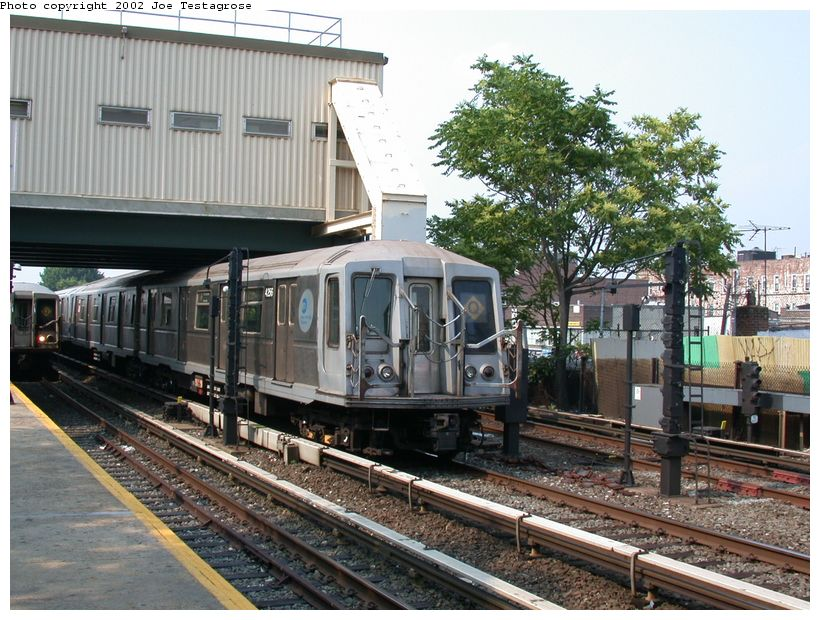 (154k, 820x620)<br><b>Country:</b> United States<br><b>City:</b> New York<br><b>System:</b> New York City Transit<br><b>Line:</b> BMT Brighton Line<br><b>Location:</b> Kings Highway <br><b>Route:</b> Q<br><b>Car:</b> R-40 (St. Louis, 1968)  4256 <br><b>Photo by:</b> Joe Testagrose<br><b>Date:</b> 6/11/2002<br><b>Viewed (this week/total):</b> 1 / 2670