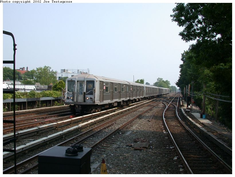 (124k, 820x620)<br><b>Country:</b> United States<br><b>City:</b> New York<br><b>System:</b> New York City Transit<br><b>Line:</b> BMT Brighton Line<br><b>Location:</b> Kings Highway <br><b>Route:</b> Q<br><b>Car:</b> R-40 (St. Louis, 1968)  4376 <br><b>Photo by:</b> Joe Testagrose<br><b>Date:</b> 6/11/2002<br><b>Viewed (this week/total):</b> 1 / 2373