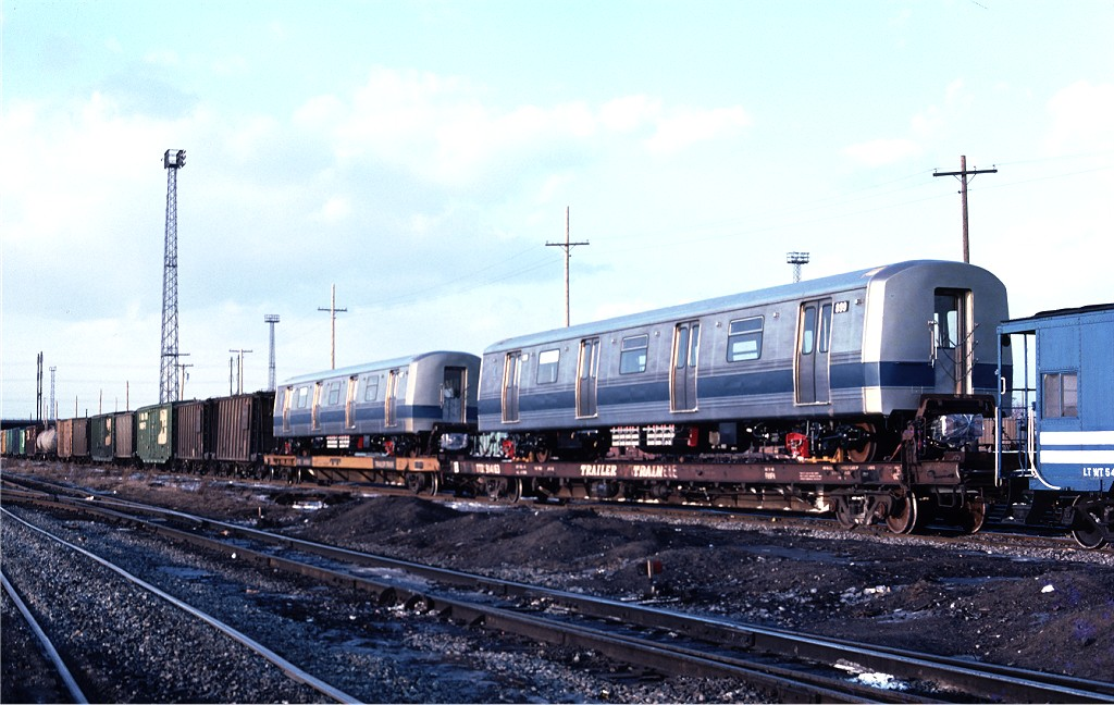 (179k, 1024x648)<br><b>Country:</b> United States<br><b>City:</b> Secaucus, NJ<br><b>System:</b> New York City Transit<br><b>Location:</b> Croxton Yard (NYCTA Equipment Delivery)<br><b>Car:</b> R-46 (Pullman-Standard, 1974-75) 899 <br><b>Photo by:</b> Ed McKernan<br><b>Collection of:</b> Joe Testagrose<br><b>Date:</b> 2/1/1977<br><b>Viewed (this week/total):</b> 5 / 233