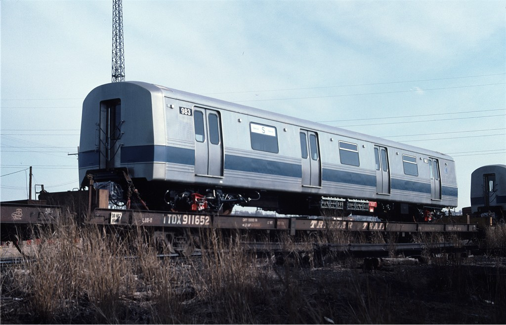(160k, 1024x659)<br><b>Country:</b> United States<br><b>City:</b> Secaucus, NJ<br><b>System:</b> New York City Transit<br><b>Location:</b> Croxton Yard (NYCTA Equipment Delivery)<br><b>Car:</b> R-46 (Pullman-Standard, 1974-75) 983 <br><b>Photo by:</b> Ed McKernan<br><b>Collection of:</b> Joe Testagrose<br><b>Date:</b> 4/1977<br><b>Viewed (this week/total):</b> 7 / 420