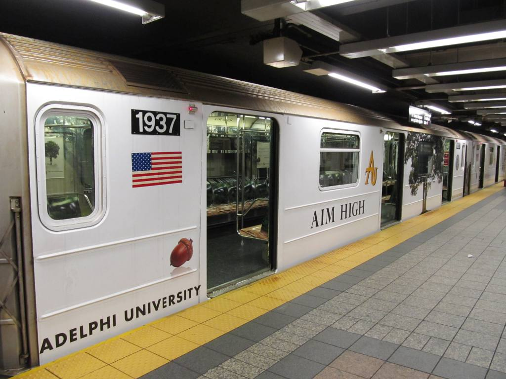 (112k, 1024x768)<br><b>Country:</b> United States<br><b>City:</b> New York<br><b>System:</b> New York City Transit<br><b>Line:</b> IRT Times Square-Grand Central Shuttle<br><b>Location:</b> Grand Central <br><b>Route:</b> S<br><b>Car:</b> R-62A (Bombardier, 1984-1987)  1937 <br><b>Photo by:</b> Robbie Rosenfeld<br><b>Date:</b> 3/30/2011<br><b>Notes:</b> Adelphi U. wrap.<br><b>Viewed (this week/total):</b> 0 / 412