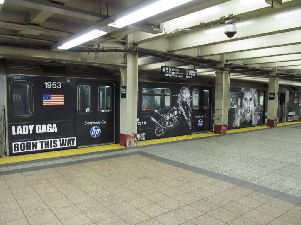 (112k, 1024x768)<br><b>Country:</b> United States<br><b>City:</b> New York<br><b>System:</b> New York City Transit<br><b>Line:</b> IRT Times Square-Grand Central Shuttle<br><b>Location:</b> Grand Central <br><b>Route:</b> S<br><b>Car:</b> R-62A (Bombardier, 1984-1987)  1953 <br><b>Photo by:</b> Robbie Rosenfeld<br><b>Date:</b> 6/13/2011<br><b>Notes:</b> Lady Gaga ad wrap.<br><b>Viewed (this week/total):</b> 0 / 545