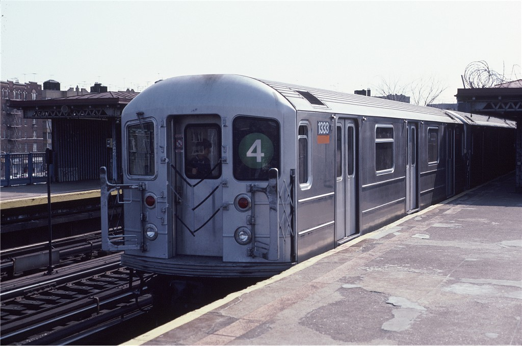 (163k, 1024x679)<br><b>Country:</b> United States<br><b>City:</b> New York<br><b>System:</b> New York City Transit<br><b>Line:</b> IRT Woodlawn Line<br><b>Location:</b> Bedford Park Boulevard <br><b>Route:</b> 4<br><b>Car:</b> R-62 (Kawasaki, 1983-1985)  1333 <br><b>Photo by:</b> Eric Oszustowicz<br><b>Collection of:</b> Joe Testagrose<br><b>Date:</b> 4/13/1985<br><b>Viewed (this week/total):</b> 5 / 1782