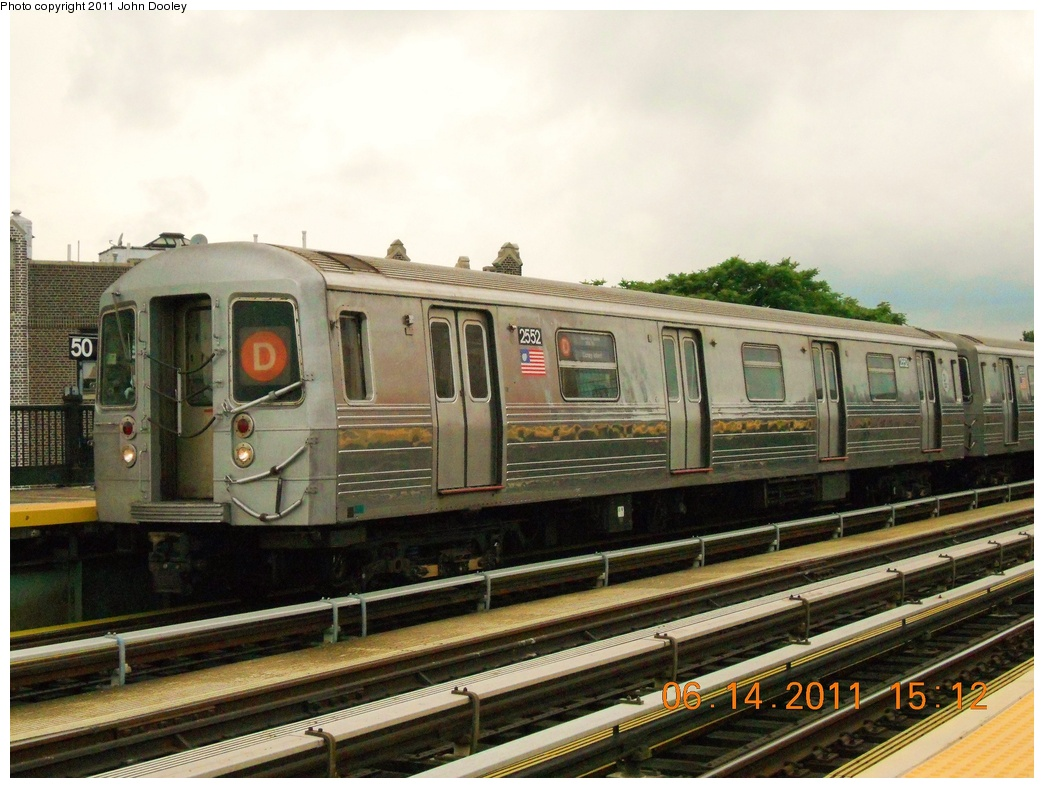 (355k, 1044x788)<br><b>Country:</b> United States<br><b>City:</b> New York<br><b>System:</b> New York City Transit<br><b>Line:</b> BMT West End Line<br><b>Location:</b> 50th Street <br><b>Route:</b> D<br><b>Car:</b> R-68 (Westinghouse-Amrail, 1986-1988)  2552 <br><b>Photo by:</b> John Dooley<br><b>Date:</b> 6/14/2011<br><b>Notes:</b> Note repainted end bonnet.<br><b>Viewed (this week/total):</b> 2 / 733