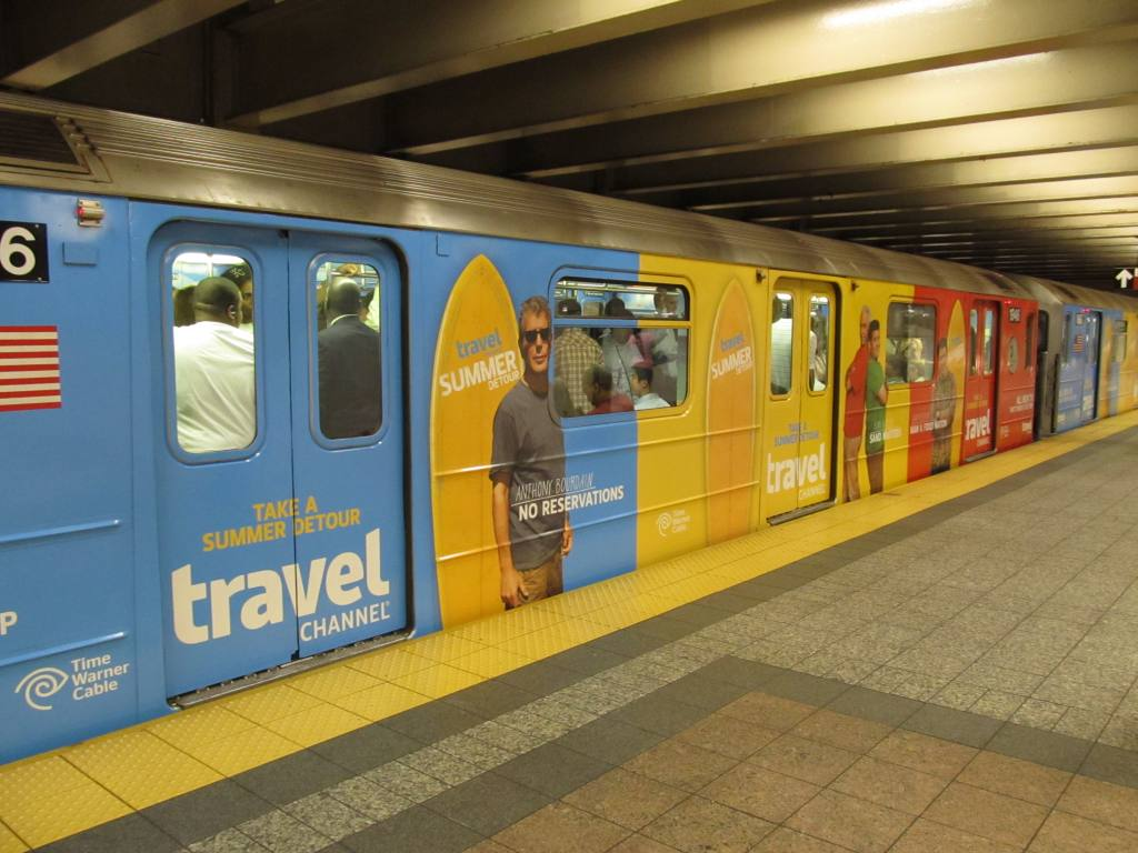 (109k, 1024x768)<br><b>Country:</b> United States<br><b>City:</b> New York<br><b>System:</b> New York City Transit<br><b>Line:</b> IRT Times Square-Grand Central Shuttle<br><b>Location:</b> Grand Central <br><b>Route:</b> S<br><b>Car:</b> R-62A (Bombardier, 1984-1987)  1946 <br><b>Photo by:</b> Robbie Rosenfeld<br><b>Date:</b> 7/14/2011<br><b>Notes:</b> Travel Channel wrap.<br><b>Viewed (this week/total):</b> 3 / 294