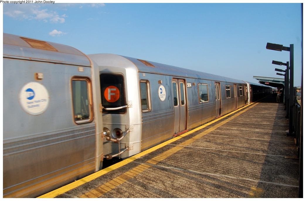 (287k, 1044x686)<br><b>Country:</b> United States<br><b>City:</b> New York<br><b>System:</b> New York City Transit<br><b>Line:</b> BMT Culver Line<br><b>Location:</b> Bay Parkway (22nd Avenue) <br><b>Route:</b> F<br><b>Car:</b> R-46 (Pullman-Standard, 1974-75) 5614 <br><b>Photo by:</b> John Dooley<br><b>Date:</b> 7/26/2011<br><b>Viewed (this week/total):</b> 1 / 673