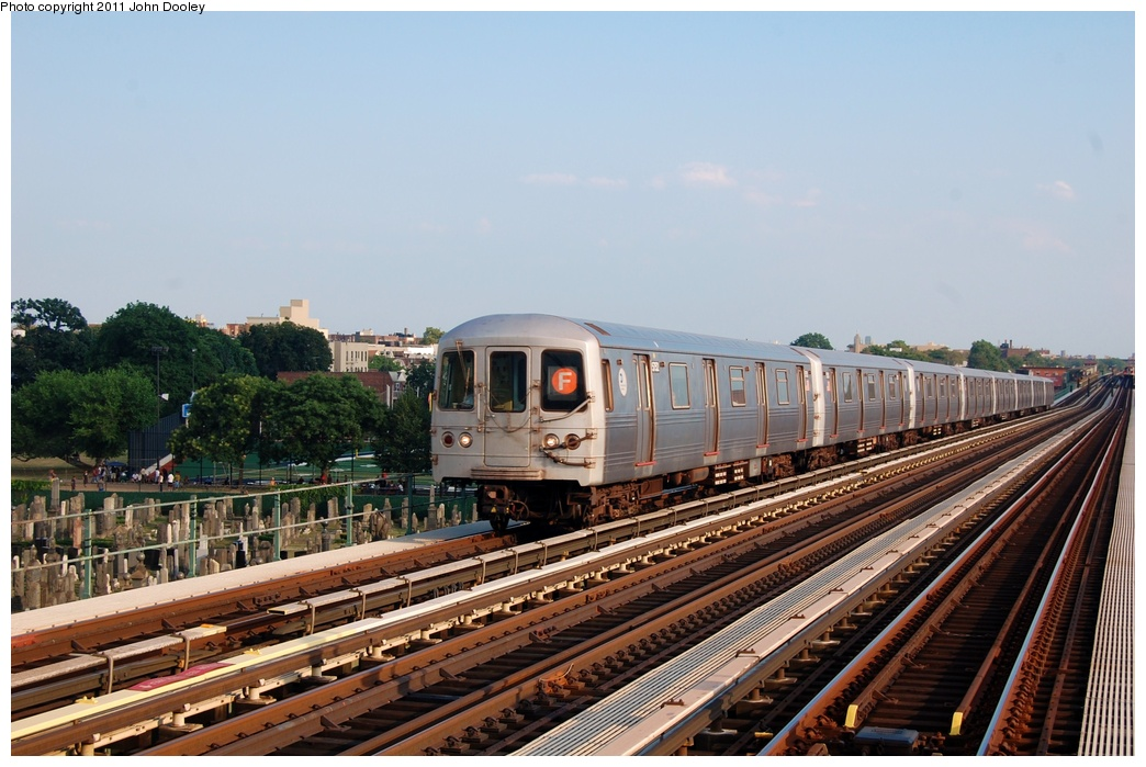 (313k, 1044x699)<br><b>Country:</b> United States<br><b>City:</b> New York<br><b>System:</b> New York City Transit<br><b>Line:</b> BMT Culver Line<br><b>Location:</b> Bay Parkway (22nd Avenue) <br><b>Route:</b> F<br><b>Car:</b> R-46 (Pullman-Standard, 1974-75) 5686 <br><b>Photo by:</b> John Dooley<br><b>Date:</b> 7/26/2011<br><b>Viewed (this week/total):</b> 6 / 593