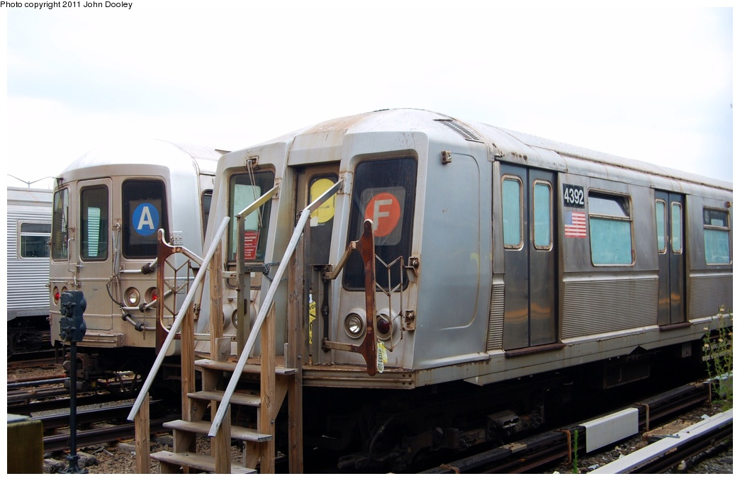 (245k, 1044x679)<br><b>Country:</b> United States<br><b>City:</b> New York<br><b>System:</b> New York City Transit<br><b>Location:</b> Rockaway Park Yard<br><b>Car:</b> R-40 (St. Louis, 1968)  4392 <br><b>Photo by:</b> John Dooley<br><b>Date:</b> 7/24/2011<br><b>Notes:</b> School car; With R-46 6222<br><b>Viewed (this week/total):</b> 0 / 652