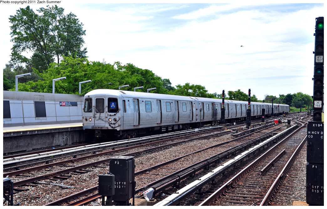 (446k, 1044x666)<br><b>Country:</b> United States<br><b>City:</b> New York<br><b>System:</b> New York City Transit<br><b>Line:</b> IND Rockaway<br><b>Location:</b> Howard Beach <br><b>Route:</b> A<br><b>Car:</b> R-46 (Pullman-Standard, 1974-75) 5852 <br><b>Photo by:</b> Zach Summer<br><b>Date:</b> 7/28/2011<br><b>Viewed (this week/total):</b> 2 / 250