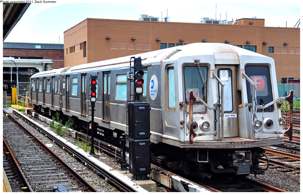 (455k, 1044x672)<br><b>Country:</b> United States<br><b>City:</b> New York<br><b>System:</b> New York City Transit<br><b>Location:</b> Rockaway Park Yard<br><b>Car:</b> R-40 (St. Louis, 1968)  4393 <br><b>Photo by:</b> Zach Summer<br><b>Date:</b> 7/28/2011<br><b>Notes:</b> School car<br><b>Viewed (this week/total):</b> 3 / 968