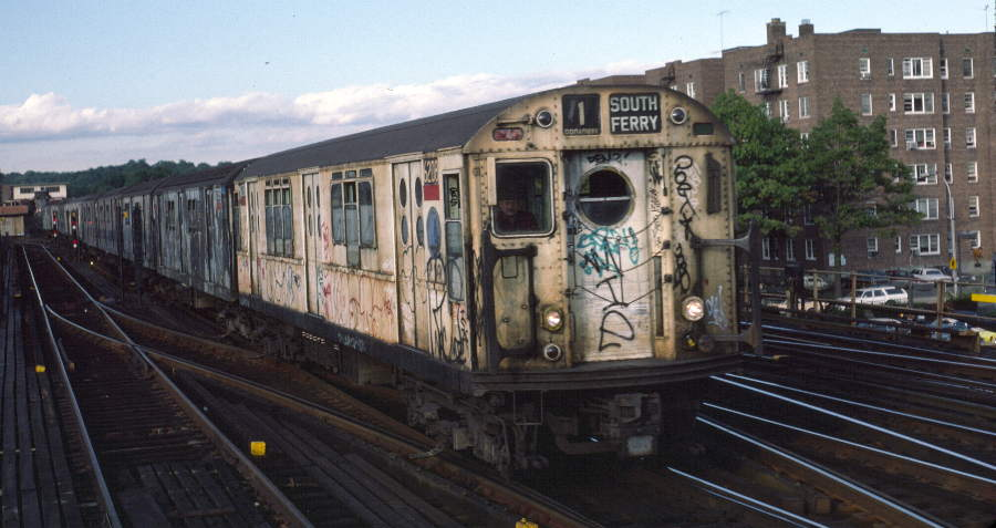 (62k, 900x477)<br><b>Country:</b> United States<br><b>City:</b> New York<br><b>System:</b> New York City Transit<br><b>Line:</b> IRT West Side Line<br><b>Location:</b> 238th Street <br><b>Route:</b> 1<br><b>Car:</b> R-15 (American Car & Foundry, 1950) 6208 <br><b>Photo by:</b> Robert Callahan<br><b>Date:</b> 10/5/1984<br><b>Viewed (this week/total):</b> 0 / 474