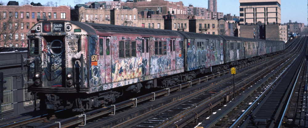 (67k, 1000x417)<br><b>Country:</b> United States<br><b>City:</b> New York<br><b>System:</b> New York City Transit<br><b>Line:</b> IRT West Side Line<br><b>Location:</b> 207th Street <br><b>Route:</b> 1<br><b>Car:</b> R-17 (St. Louis, 1955-56) 6570 <br><b>Photo by:</b> Robert Callahan<br><b>Date:</b> 2/10/1985<br><b>Viewed (this week/total):</b> 4 / 355