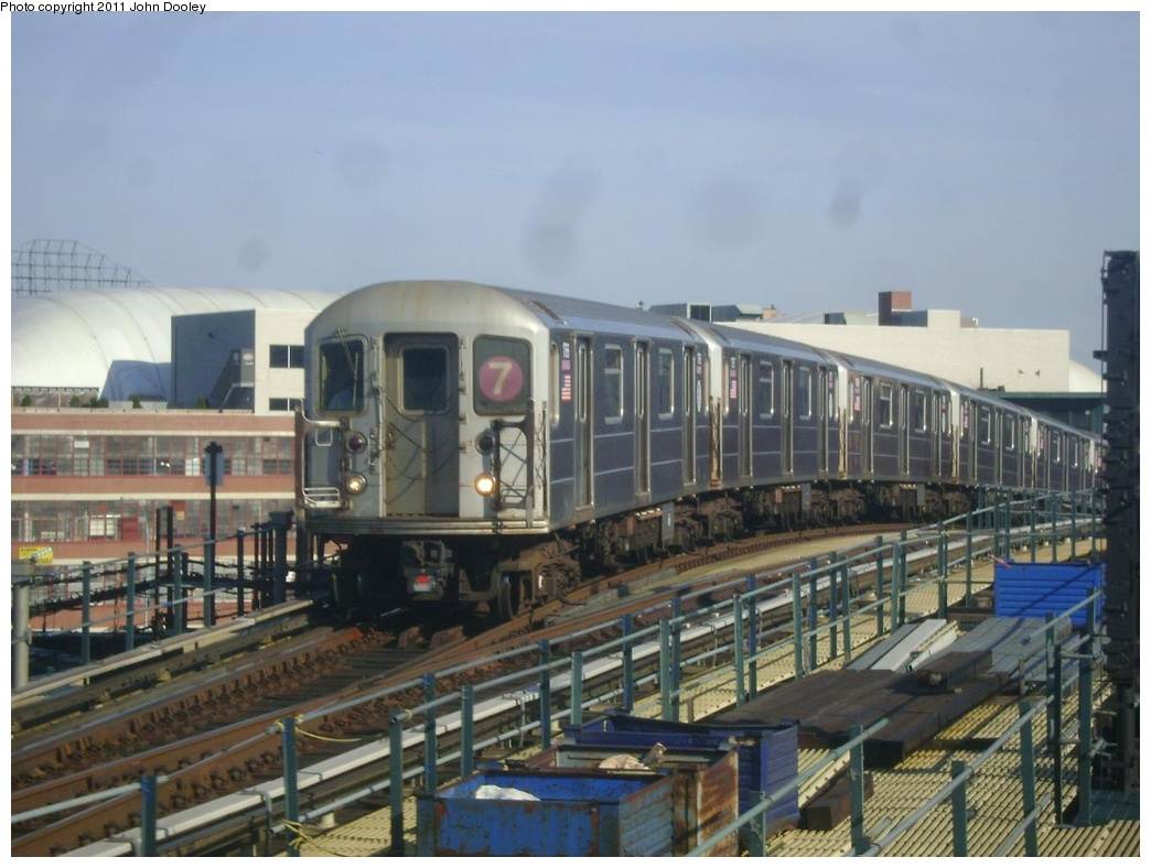 (269k, 1044x788)<br><b>Country:</b> United States<br><b>City:</b> New York<br><b>System:</b> New York City Transit<br><b>Line:</b> IRT Flushing Line<br><b>Location:</b> 33rd Street/Rawson Street <br><b>Route:</b> 7<br><b>Car:</b> R-62A (Bombardier, 1984-1987)  1766 <br><b>Photo by:</b> John Dooley<br><b>Date:</b> 4/14/2011<br><b>Viewed (this week/total):</b> 2 / 266