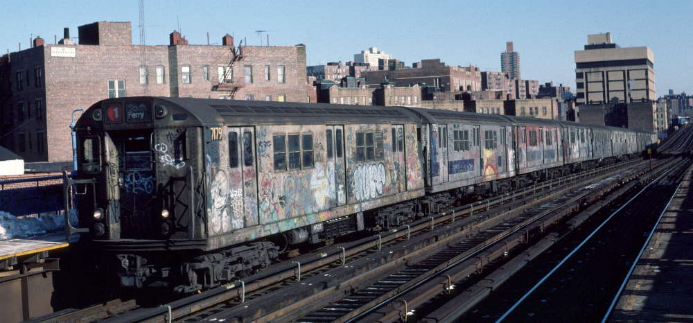 (70k, 1000x466)<br><b>Country:</b> United States<br><b>City:</b> New York<br><b>System:</b> New York City Transit<br><b>Line:</b> IRT West Side Line<br><b>Location:</b> 207th Street <br><b>Route:</b> 1<br><b>Car:</b> R-21 (St. Louis, 1956-57) 7179 <br><b>Photo by:</b> Robert Callahan<br><b>Date:</b> 2/10/1985<br><b>Viewed (this week/total):</b> 3 / 326