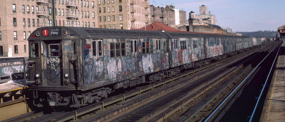 (65k, 1000x429)<br><b>Country:</b> United States<br><b>City:</b> New York<br><b>System:</b> New York City Transit<br><b>Line:</b> IRT West Side Line<br><b>Location:</b> 231st Street <br><b>Route:</b> 1<br><b>Car:</b> R-21 (St. Louis, 1956-57) 7184 <br><b>Photo by:</b> Robert Callahan<br><b>Date:</b> 1/12/1985<br><b>Viewed (this week/total):</b> 2 / 263