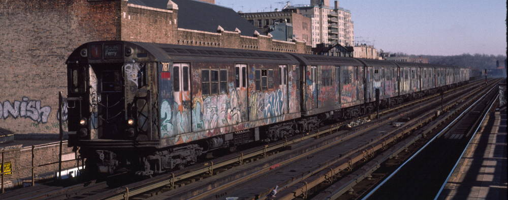 (70k, 1000x393)<br><b>Country:</b> United States<br><b>City:</b> New York<br><b>System:</b> New York City Transit<br><b>Line:</b> IRT West Side Line<br><b>Location:</b> 231st Street <br><b>Route:</b> 1<br><b>Car:</b> R-21 (St. Louis, 1956-57) 7187 <br><b>Photo by:</b> Robert Callahan<br><b>Date:</b> 2/18/1985<br><b>Viewed (this week/total):</b> 0 / 467