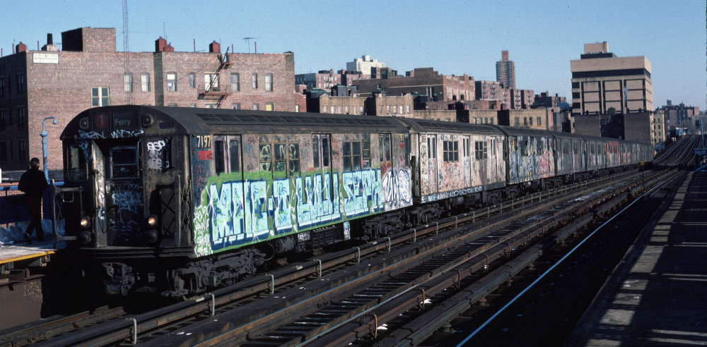 (72k, 1000x492)<br><b>Country:</b> United States<br><b>City:</b> New York<br><b>System:</b> New York City Transit<br><b>Line:</b> IRT West Side Line<br><b>Location:</b> 207th Street <br><b>Route:</b> 1<br><b>Car:</b> R-21 (St. Louis, 1956-57) 7197 <br><b>Photo by:</b> Robert Callahan<br><b>Date:</b> 2/10/1985<br><b>Viewed (this week/total):</b> 12 / 817
