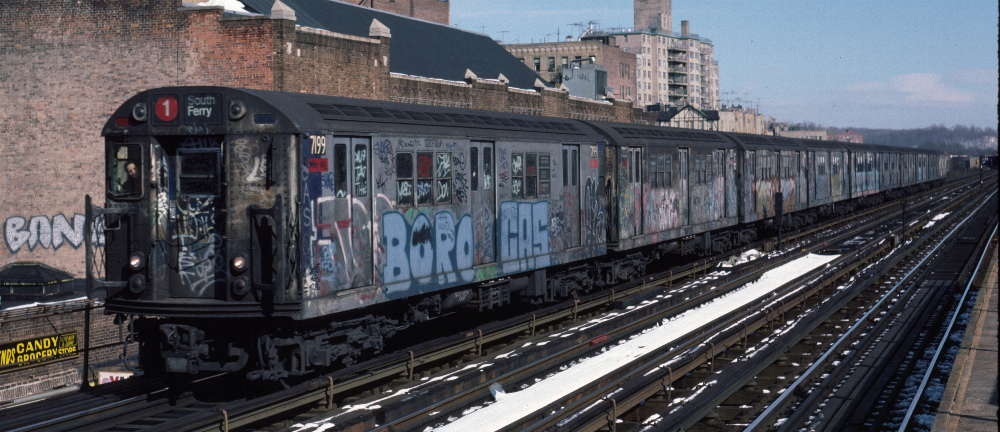 (69k, 1000x432)<br><b>Country:</b> United States<br><b>City:</b> New York<br><b>System:</b> New York City Transit<br><b>Line:</b> IRT West Side Line<br><b>Location:</b> 231st Street <br><b>Route:</b> 1<br><b>Car:</b> R-21 (St. Louis, 1956-57) 7199 <br><b>Photo by:</b> Robert Callahan<br><b>Date:</b> 2/9/1985<br><b>Viewed (this week/total):</b> 1 / 308