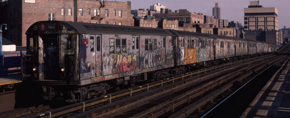 (67k, 1000x406)<br><b>Country:</b> United States<br><b>City:</b> New York<br><b>System:</b> New York City Transit<br><b>Line:</b> IRT West Side Line<br><b>Location:</b> 207th Street <br><b>Route:</b> 1<br><b>Car:</b> R-21 (St. Louis, 1956-57) 7199 <br><b>Photo by:</b> Robert Callahan<br><b>Date:</b> 2/16/1985<br><b>Viewed (this week/total):</b> 0 / 417