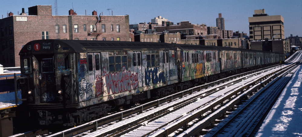 (71k, 1000x454)<br><b>Country:</b> United States<br><b>City:</b> New York<br><b>System:</b> New York City Transit<br><b>Line:</b> IRT West Side Line<br><b>Location:</b> 207th Street <br><b>Route:</b> 1<br><b>Car:</b> R-21 (St. Louis, 1956-57) 7203 <br><b>Photo by:</b> Robert Callahan<br><b>Date:</b> 2/3/1985<br><b>Viewed (this week/total):</b> 8 / 516