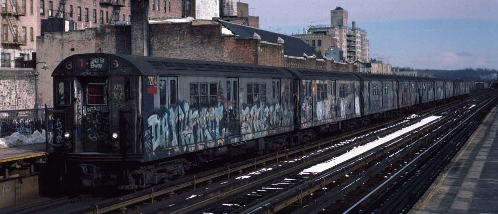 (68k, 1000x430)<br><b>Country:</b> United States<br><b>City:</b> New York<br><b>System:</b> New York City Transit<br><b>Line:</b> IRT West Side Line<br><b>Location:</b> 231st Street <br><b>Route:</b> 1<br><b>Car:</b> R-21 (St. Louis, 1956-57) 7204 <br><b>Photo by:</b> Robert Callahan<br><b>Date:</b> 2/9/1985<br><b>Viewed (this week/total):</b> 2 / 225