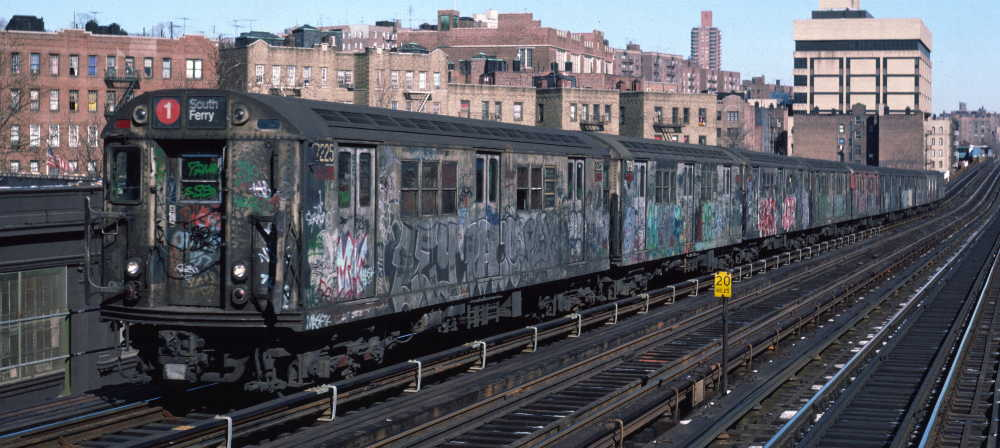 (67k, 1000x448)<br><b>Country:</b> United States<br><b>City:</b> New York<br><b>System:</b> New York City Transit<br><b>Line:</b> IRT West Side Line<br><b>Location:</b> 207th Street <br><b>Route:</b> 1<br><b>Car:</b> R-21 (St. Louis, 1956-57) 7225 <br><b>Photo by:</b> Robert Callahan<br><b>Date:</b> 2/10/1985<br><b>Viewed (this week/total):</b> 4 / 271