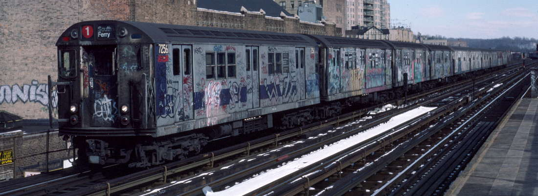 (71k, 1100x401)<br><b>Country:</b> United States<br><b>City:</b> New York<br><b>System:</b> New York City Transit<br><b>Line:</b> IRT West Side Line<br><b>Location:</b> 231st Street <br><b>Route:</b> 1<br><b>Car:</b> R-21 (St. Louis, 1956-57) 7256 <br><b>Photo by:</b> Robert Callahan<br><b>Date:</b> 2/9/1985<br><b>Viewed (this week/total):</b> 2 / 538