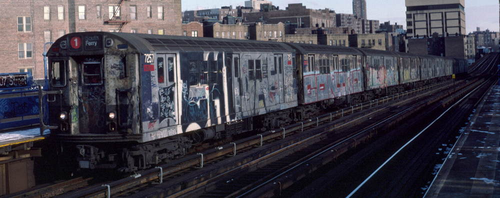 (69k, 1000x396)<br><b>Country:</b> United States<br><b>City:</b> New York<br><b>System:</b> New York City Transit<br><b>Line:</b> IRT West Side Line<br><b>Location:</b> 207th Street <br><b>Route:</b> 1<br><b>Car:</b> R-21 (St. Louis, 1956-57) 7257 <br><b>Photo by:</b> Robert Callahan<br><b>Date:</b> 2/12/1985<br><b>Viewed (this week/total):</b> 4 / 300