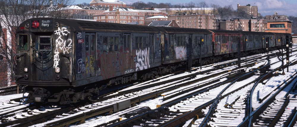 (76k, 1000x428)<br><b>Country:</b> United States<br><b>City:</b> New York<br><b>System:</b> New York City Transit<br><b>Line:</b> IRT West Side Line<br><b>Location:</b> 238th Street <br><b>Route:</b> 1<br><b>Car:</b> R-21 (St. Louis, 1956-57) 7263 <br><b>Photo by:</b> Robert Callahan<br><b>Date:</b> 1/5/1985<br><b>Viewed (this week/total):</b> 0 / 386