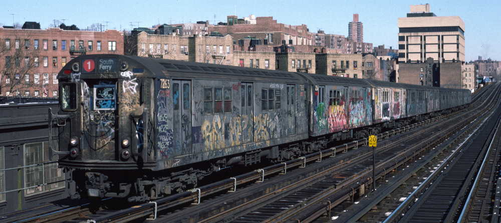 (67k, 1000x446)<br><b>Country:</b> United States<br><b>City:</b> New York<br><b>System:</b> New York City Transit<br><b>Line:</b> IRT West Side Line<br><b>Location:</b> 207th Street <br><b>Route:</b> 1<br><b>Car:</b> R-21 (St. Louis, 1956-57) 7263 <br><b>Photo by:</b> Robert Callahan<br><b>Date:</b> 2/10/1985<br><b>Viewed (this week/total):</b> 0 / 352