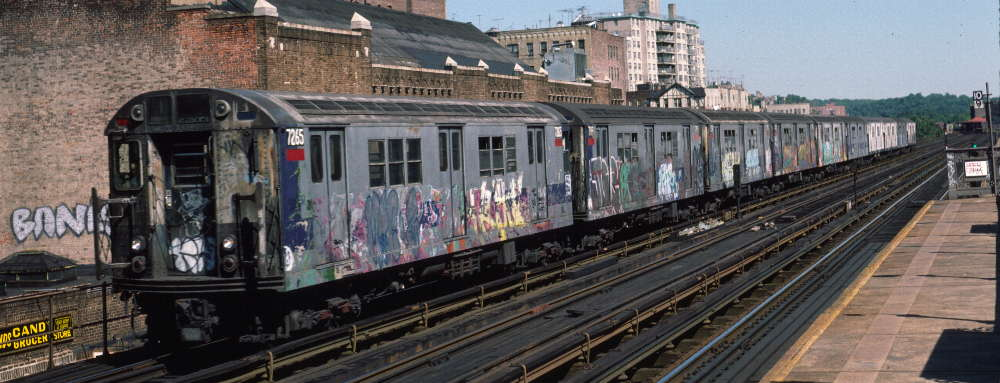 (67k, 1000x383)<br><b>Country:</b> United States<br><b>City:</b> New York<br><b>System:</b> New York City Transit<br><b>Line:</b> IRT West Side Line<br><b>Location:</b> 231st Street <br><b>Route:</b> 1<br><b>Car:</b> R-21 (St. Louis, 1956-57) 7265 <br><b>Photo by:</b> Robert Callahan<br><b>Date:</b> 9/22/1984<br><b>Viewed (this week/total):</b> 2 / 669